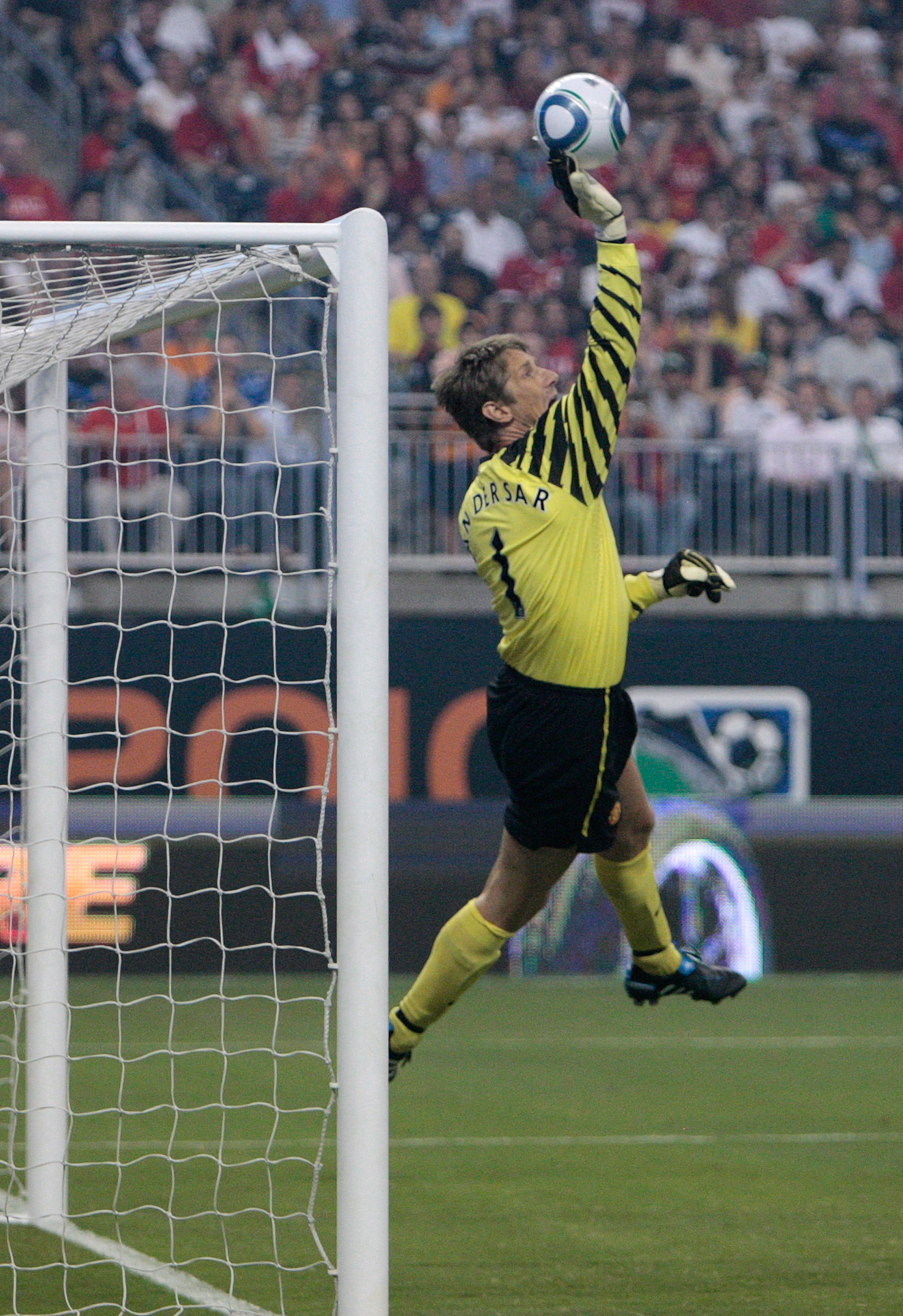 HOUSTON - JULY 28:  Edwin van der Sar #1 of Manchester United makes a save during the MLS All Star Game at Reliant Stadium on July 28, 2010 in Houston, Texas.  (Photo by Bob Levey/Getty Images)