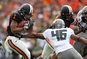 CORVALLIS, OR - DECEMBER 04:  Jacquizz Rodgers #1 of the Oregon State Beavers runs the ball against Michael Clay #46 of the Oregon Ducks during the 114th Civil War on December 4, 2010 at the Reser Stadium in Corvallis, Oregon.  (Photo by Jonathan Ferrey/G