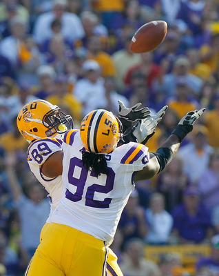 BATON ROUGE, LA - NOVEMBER 20:  Lavar Edward #89 and Drake Nevis #92 of the Louisiana State University Tigers intercept a pass broken up against the Ole Miss Rebels at Tiger Stadium on November 20, 2010 in Baton Rouge, Louisiana.  (Photo by Kevin C. Cox/G