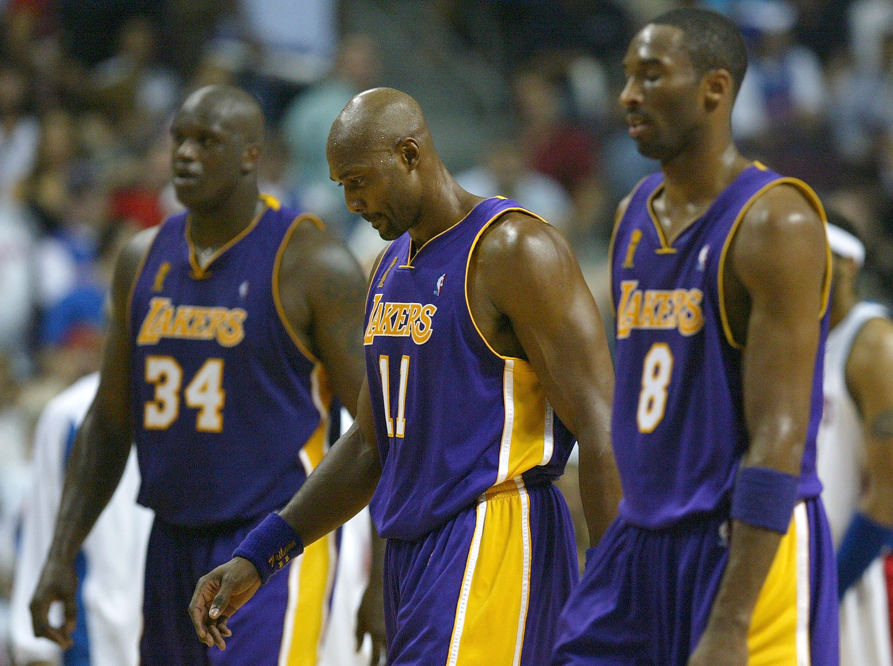 AUBURN HILLS, MI - JUNE 13:  (L-R) Shaquille O'Neal #34, Karl Malone #11 and Kobe Bryant #8 of the Los Angeles Lakers walk off the court in Game Four of the 2004 NBA Finals against the Detroit Pistons on June 13, 2004 at The Palace of Auburn Hills in Aubu