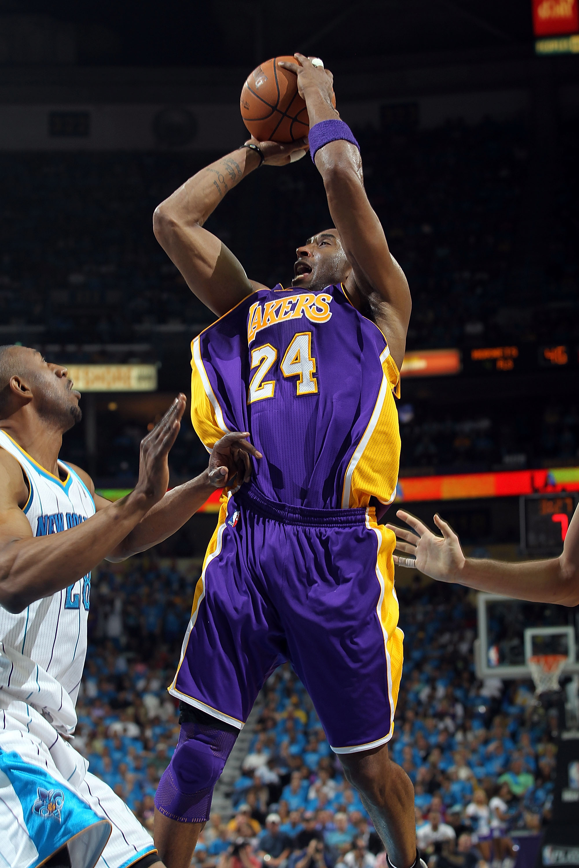 NEW ORLEANS, LA - APRIL 28:  Guard Kobe Bryant #24 of the Los Angeles Lakers takes a shot against D.J. Mbenga #28 of the New Orleans Hornets in Game Six of the Western Conference Quarterfinals in the 2011 NBA Playoffs on April 28, 2011 at New Orleans Aren