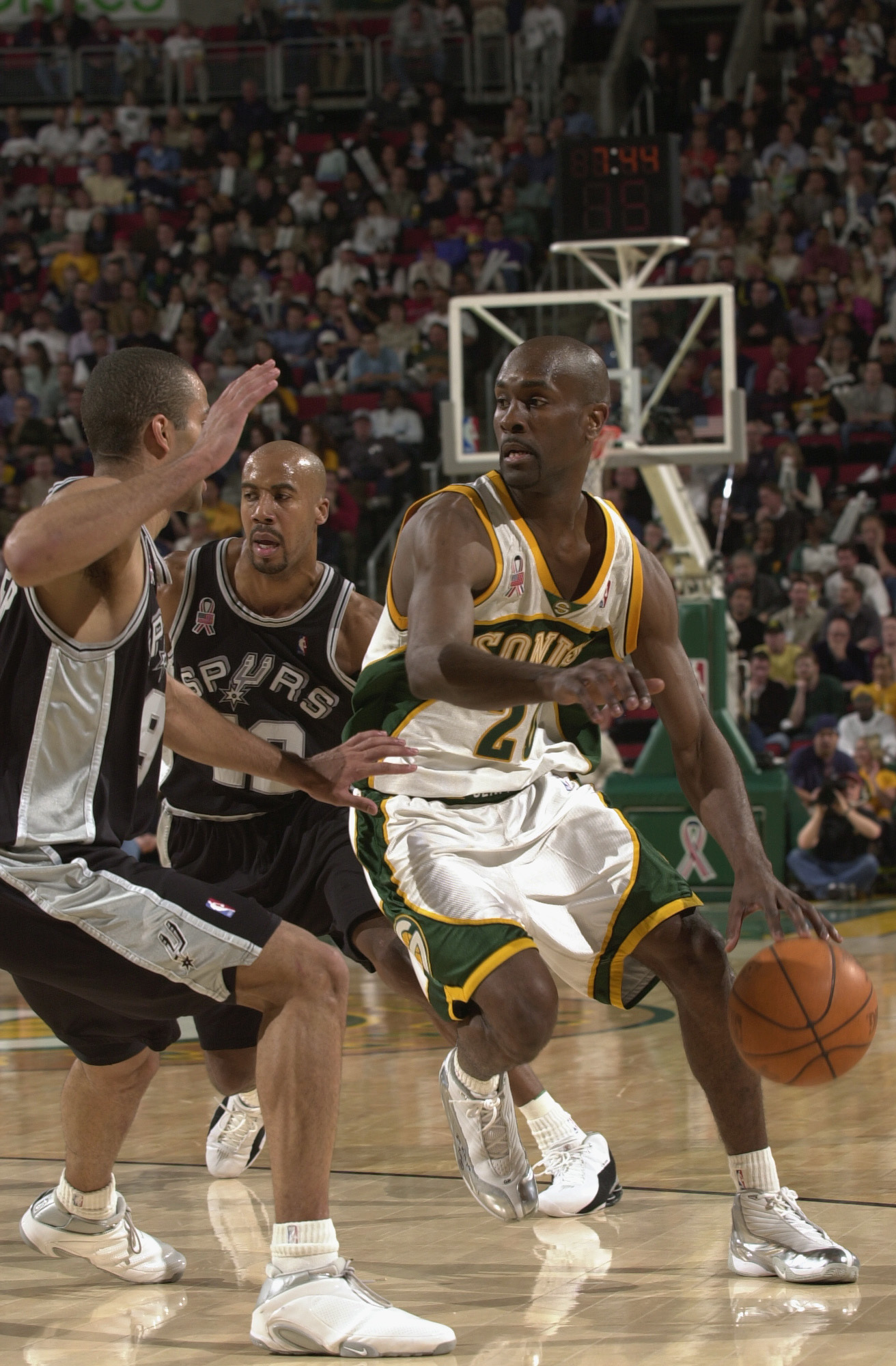SEATTLE - MAY 1:  Point guard Gary Payton #20 of the Seattle SuperSonics drives past point guard Tony Parker #9 of the San Antonio Spurs during game four of the Western Conference Quarterfinals during the 2002 NBA Playoffs at Key Arena in Seattle, Washing