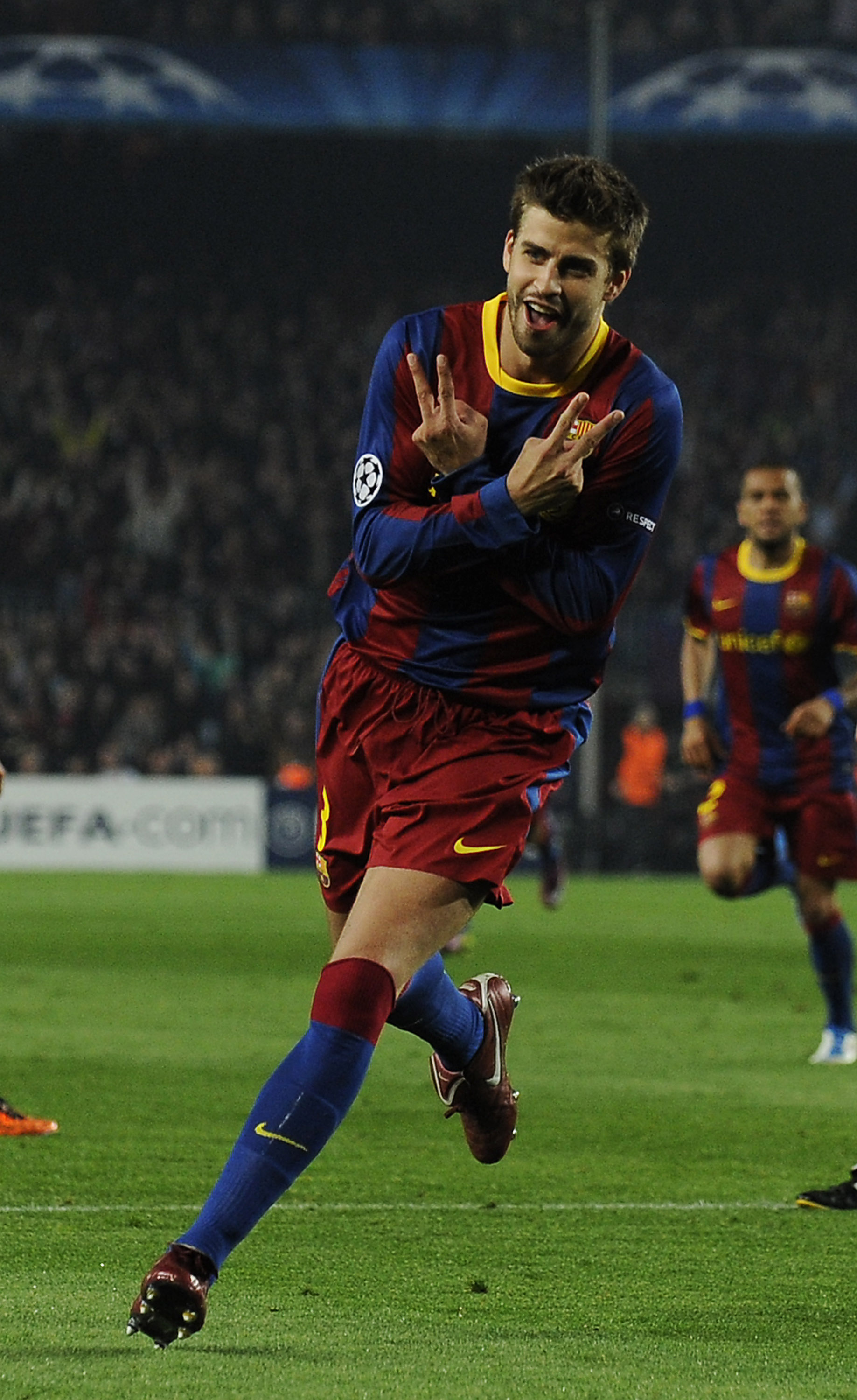 BARCELONA, SPAIN - APRIL 06:  Gerard Pique of FC Barcelona celebrates after scoring his team's third goal during the UEFA Champions League quarter final first leg match between Barcelona and Shakhtar Donetsk at the Camp Nou Stadium on April 6, 2011 in Bar