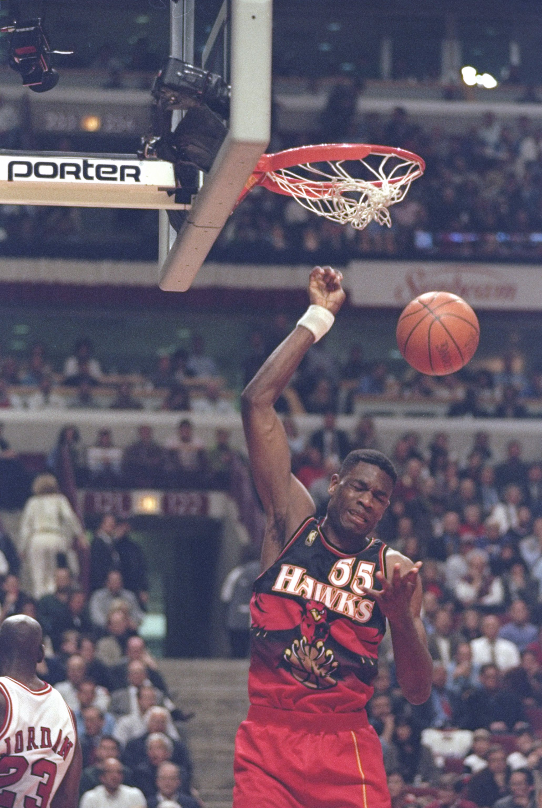 13 May 1997:  Center Dikembe Mutombo of the Atlanta Hawks slam dunks the ball during a playoff game against the Chicago Bulls at the United Center in Chicago, Illinois.  The Bulls won the game 107-92. Mandatory Credit: Jonathan Daniel  /Allsport