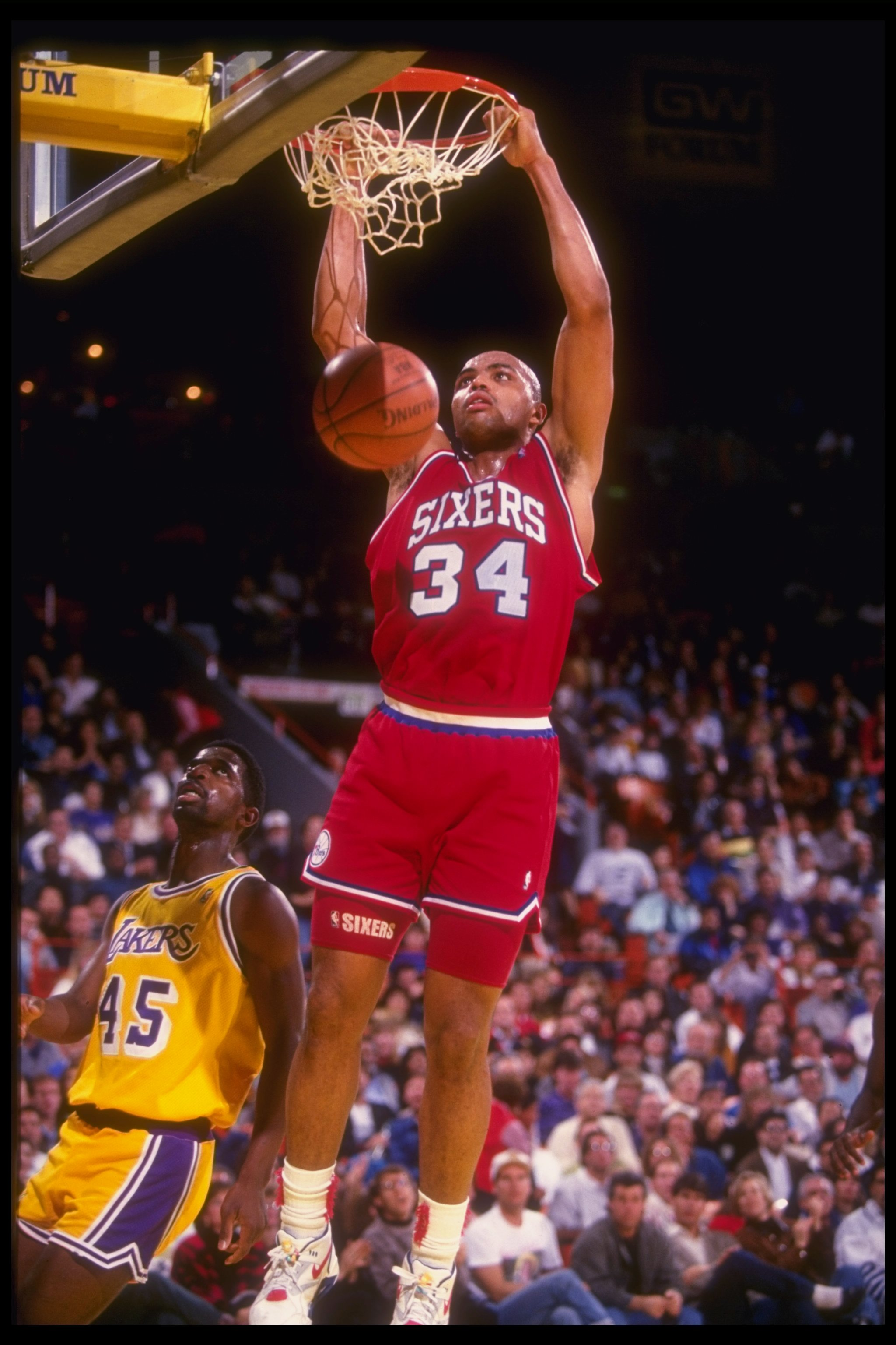 30 Dec 1990: Forward Charles Barkley of the Philadelphia 76ers sinks the ball during a game against the Los Angeles Lakers at the CoreStates Spectrum in Inglewood, California. The Lakers won the game, 115-107.