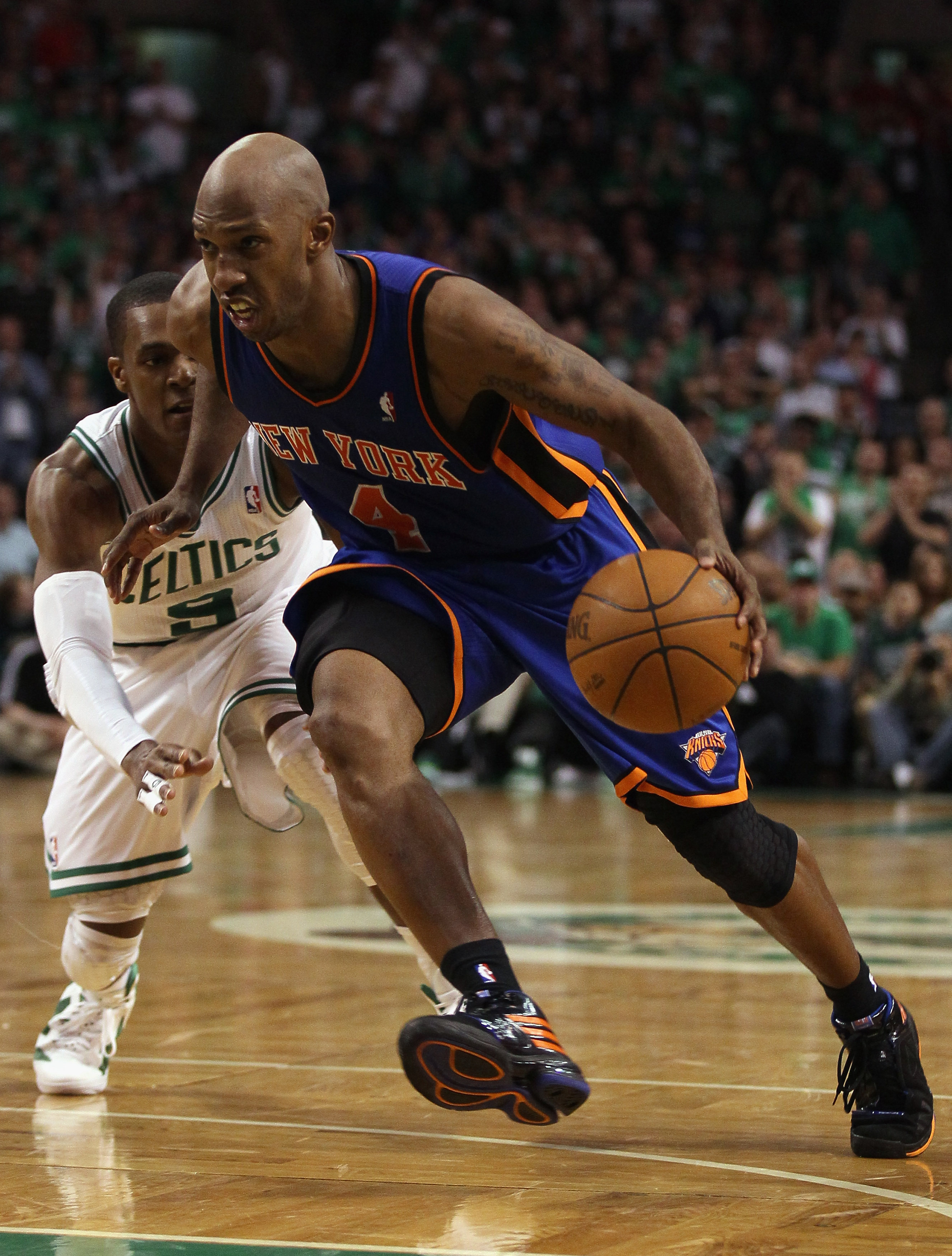 BOSTON, MA - APRIL 17:  Chauncey Billups #4 of the New York Knicks drives to the net as Rajon Rondo #9 of the Boston Celtics defends in Game One of the Eastern Conference Quarterfinals in the 2011 NBA Playoffs on April 17, 2011 at the TD Garden in Boston,