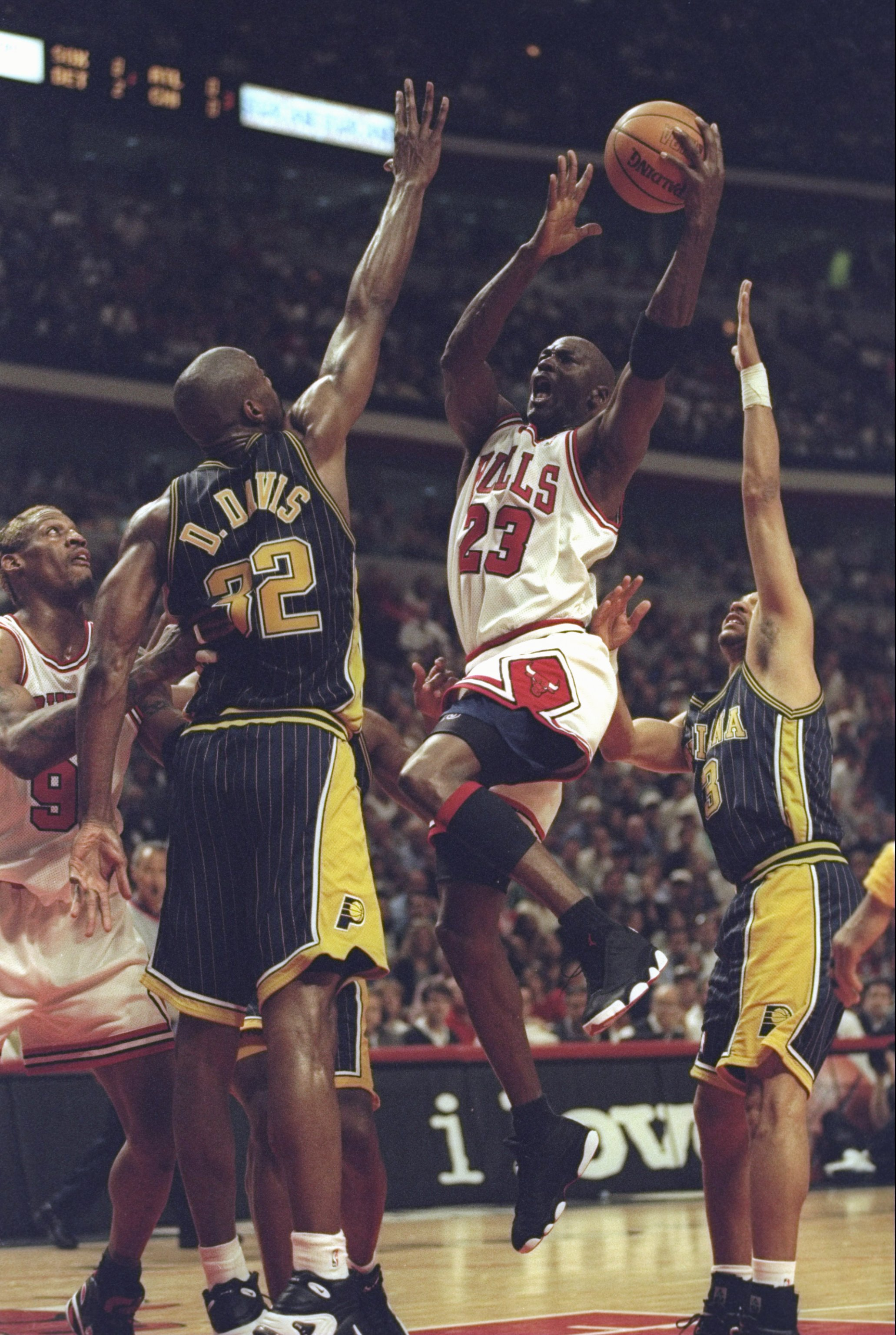 31 May 1998: Michael Jordan #23 of the Chicago Bulls drives to the basket over Dale Davis #32 of the Indiana Pacers during game seven of the Eastern Conference Finals at the United Center in Chicago, Illinois. The Bulls defeated the Pacers 88-83.