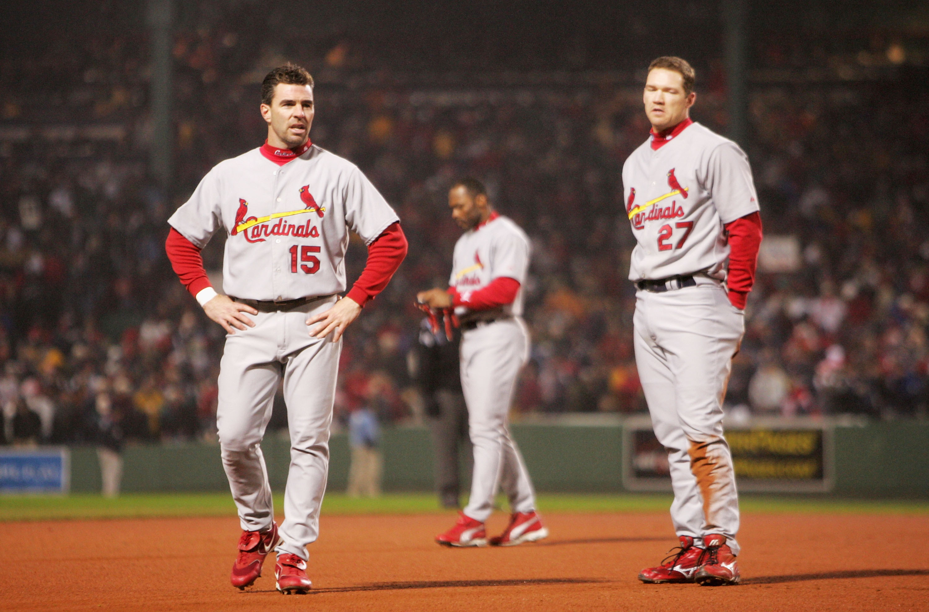 BOSTON - OCTOBER 24:  (L-R) Jim Edmonds #15, Reggie Sanders #16 and Scott Rolen #27 of the St. Louis Cardinals react after the end of the top of the sixth inning against the Boston Red Sox during game two of the World Series on October 24, 2004 at Fenway