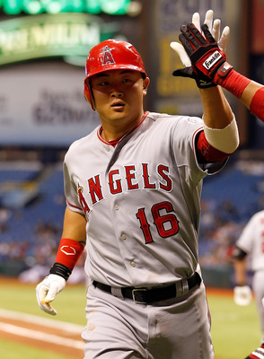 ST. PETERSBURG, FL - APRIL 05:  Hank Conger #16 of the Los Angeles Angels of Anaheim is congratulated after his second-inning home run against the Tampa Bay Rays during the game at Tropicana Field on April 5, 2011 in St. Petersburg, Florida.  (Photo by J.