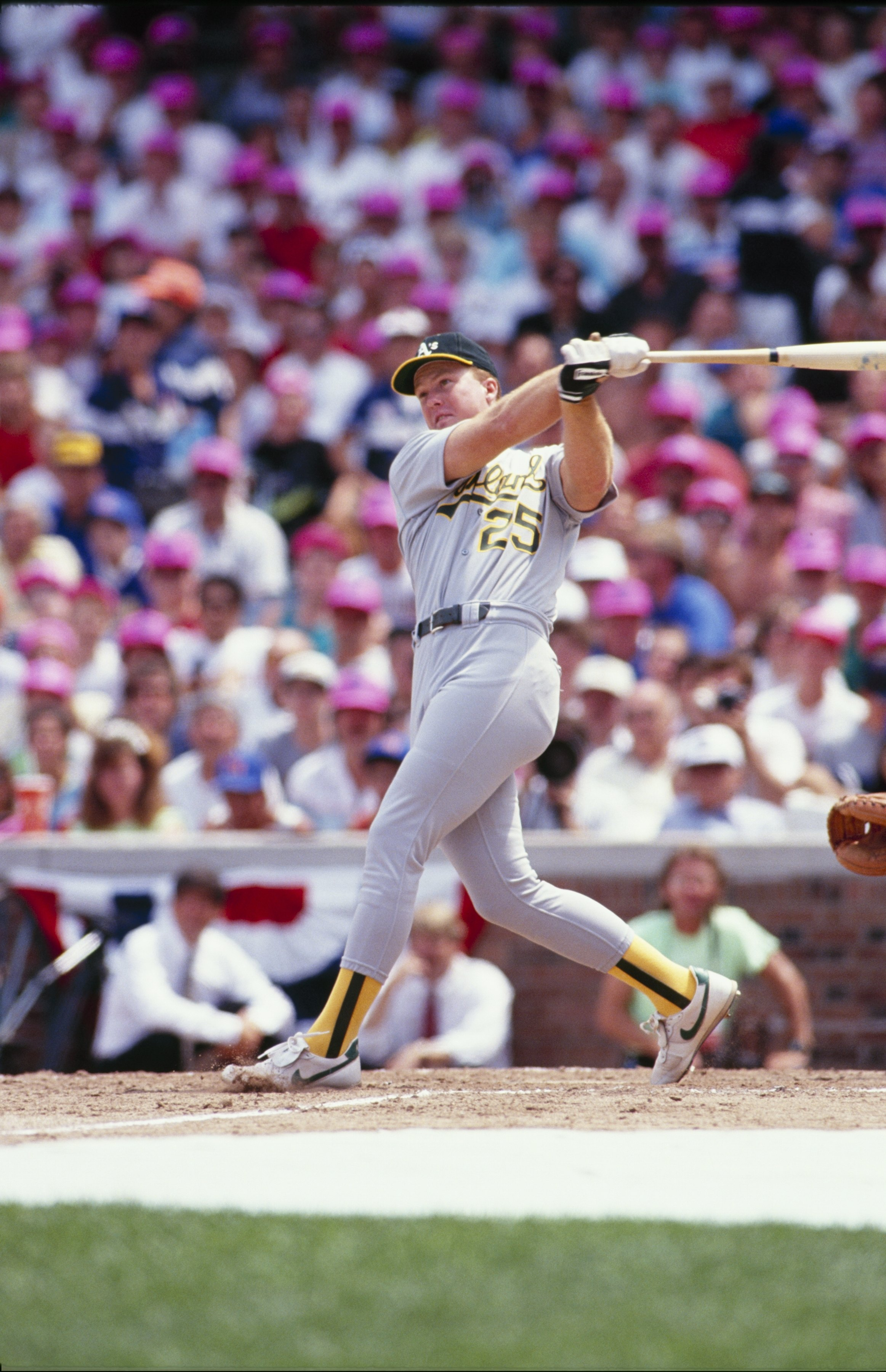 CHICAGO - JULY 1990:  Mark McGuire #25 of the Oakland Athletics bats during batting practice prior to the1990 All-Star Game at Wrigley Field circa July 1990 in Chicago, Illinois. (Photo by Steve Goldstein/Getty Images)