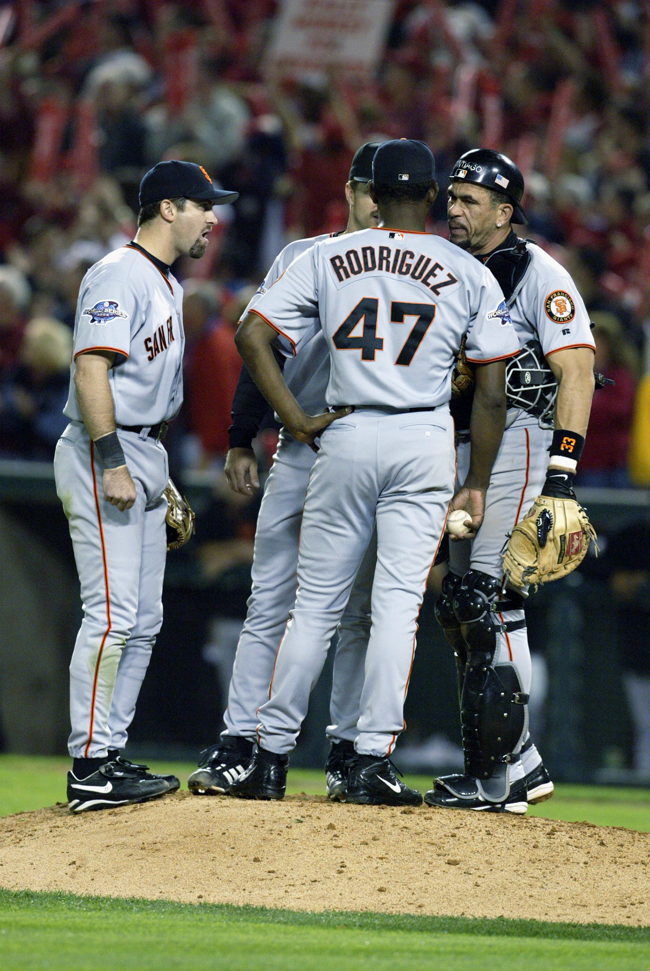 ANAHEIM, CA - OCTOBER 26:  (L-R) Shortstop Rich Aurilia #35, second baseman Jeff Kent #21, pitcher Felix Rodriguez #47 and catcher Benito Santiago #33 of the San Francisco Giants go over their options in Game six of the 2002 World Series against the Anahe