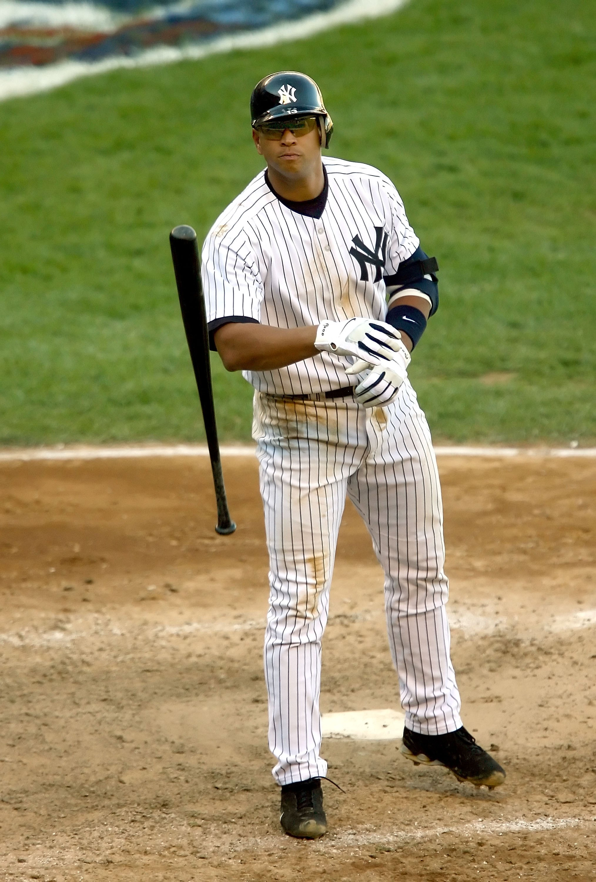 NEW YORK - OCTOBER 05:  Alex Rodriguez #13 of the New York Yankees throws his bat after being struck out in the eighth inning against the Detroit Tigers in Game Two of the American League Division Series on October 5, 2006 at Yankee Stadium in the Bronx B