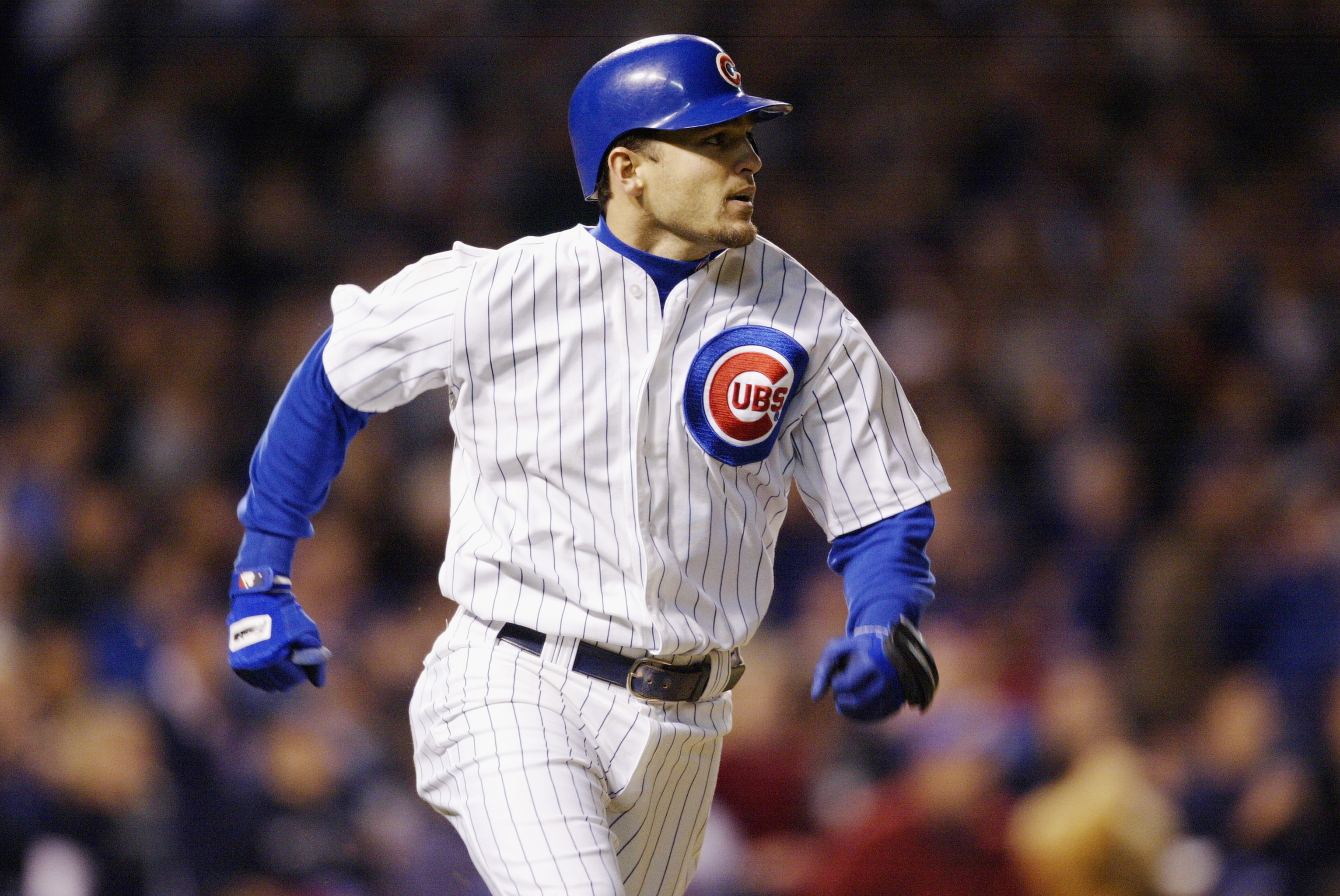 CHICAGO - OCTOBER 15:  Shortstop Alex Gonzalez #8 of the Chicago Cubs runs during game seven of the National League Championship Series against the Florida Marlins on October 15, 2003 at Wrigley Field in Chicago, Illinois. The Marlins won 9-6. (Photo by B