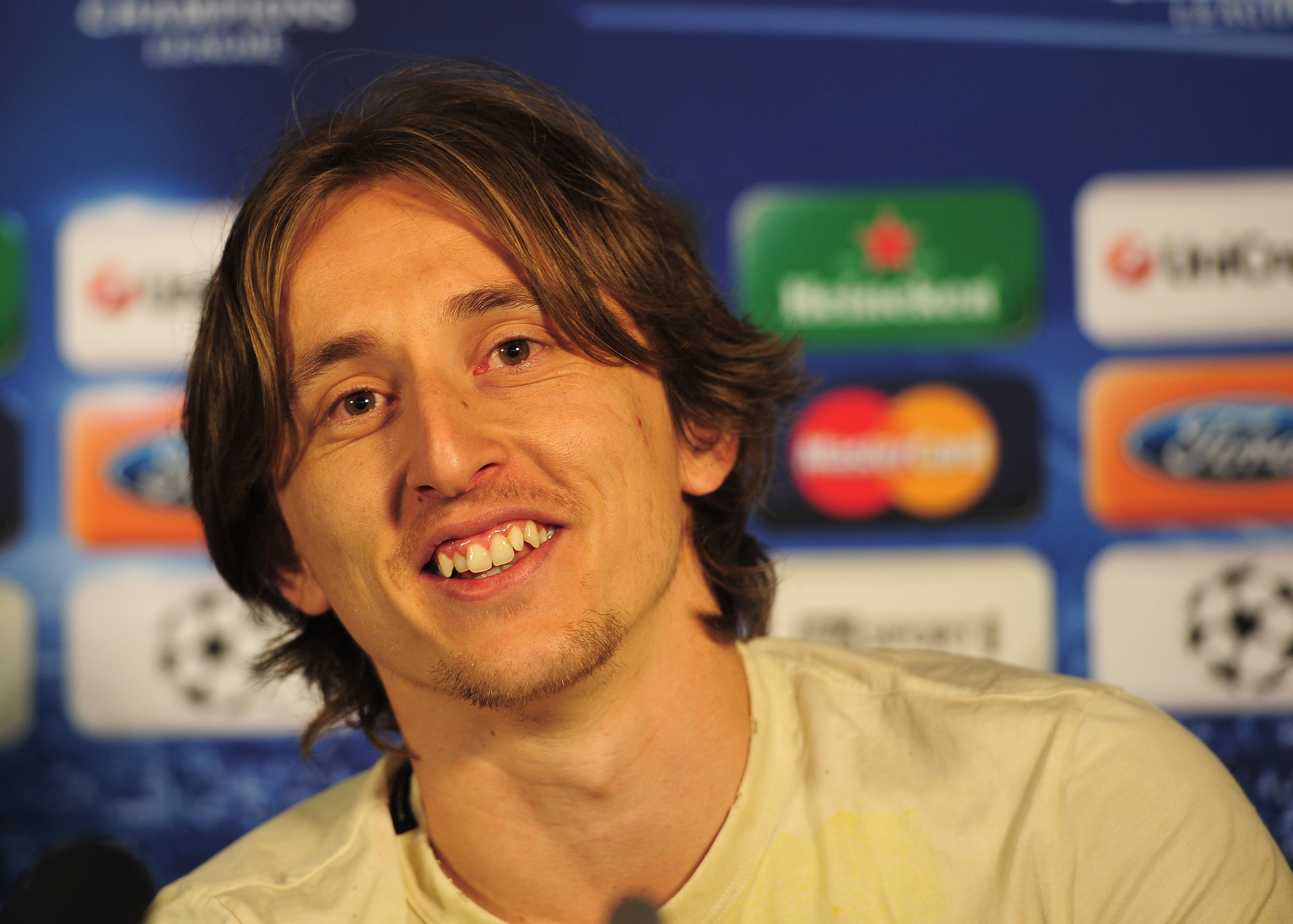LONDON, ENGLAND - APRIL 12:  Luka Modric of Tottenham Hotspur talks to the media during a press conference on the eve of their UEFA Champions League quarter-final second leg match against Real Madrid at White Hart Lane on April 12, 2011 in London, England