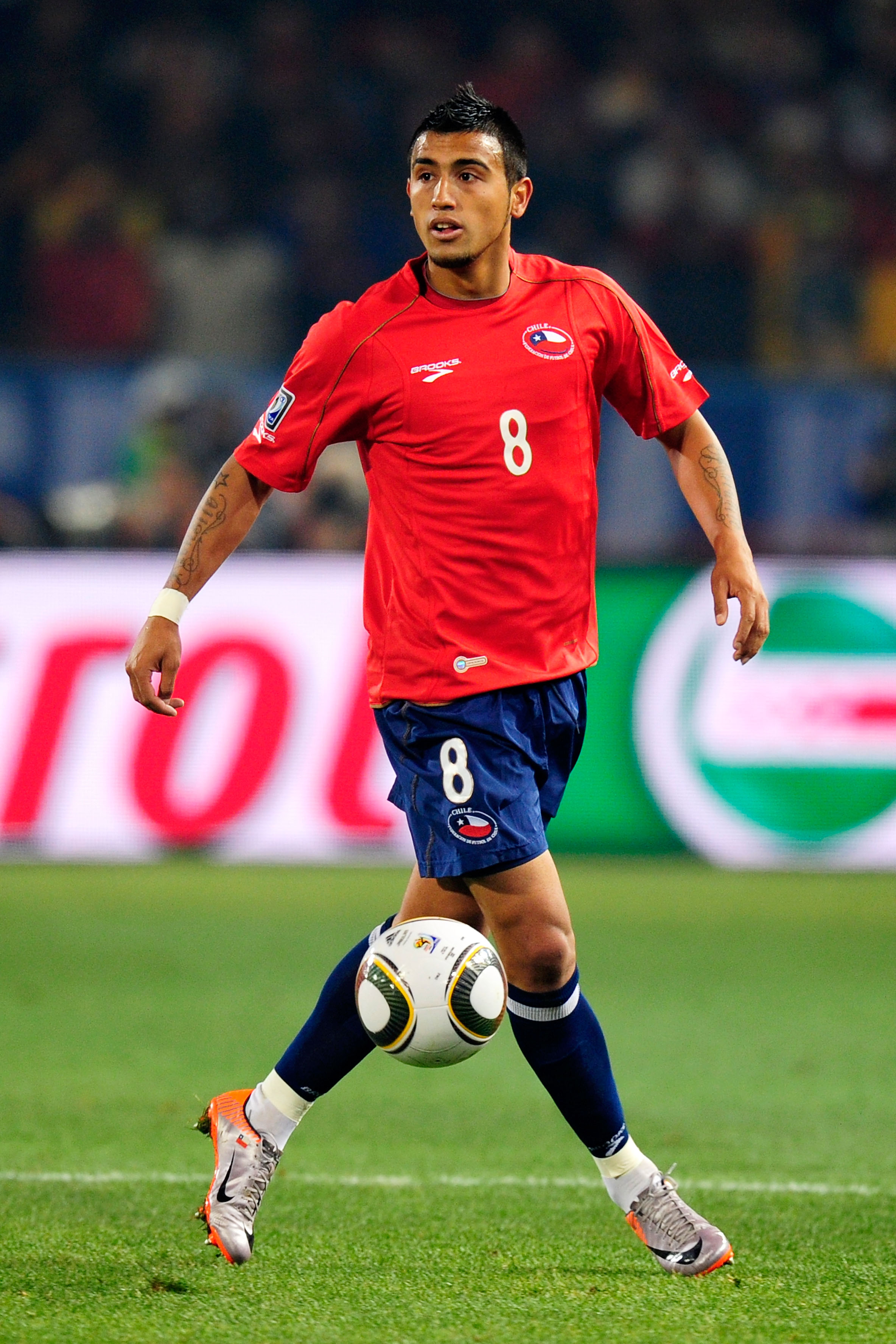 PRETORIA, SOUTH AFRICA - JUNE 25: Arturo Vidal of Chile in action during the 2010 FIFA World Cup South Africa Group H match between Chile and Spain at Loftus Versfeld Stadium on June 25, 2010 in Tshwane/Pretoria, South Africa.  (Photo by Stuart Franklin/G