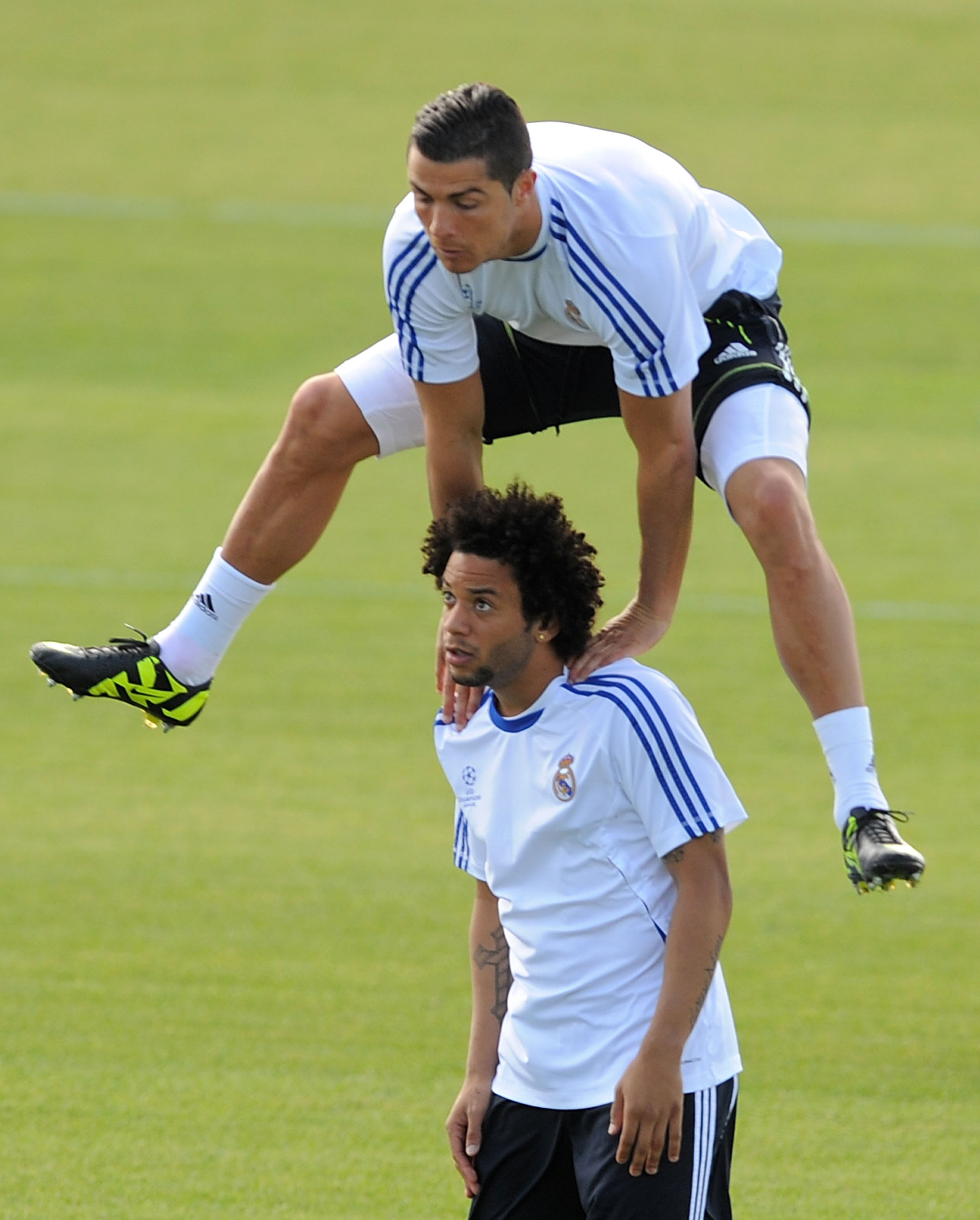 MADRID, SPAIN - APRIL 26:  Cristiano Ronaldo of Real Madrid jumps over Marcelo during a training session at Valdebebas training ground ahead of their UEFA Champions League semi-final first leg match against Barcelona on April 26, 2011 in Madrid, Spain  (P