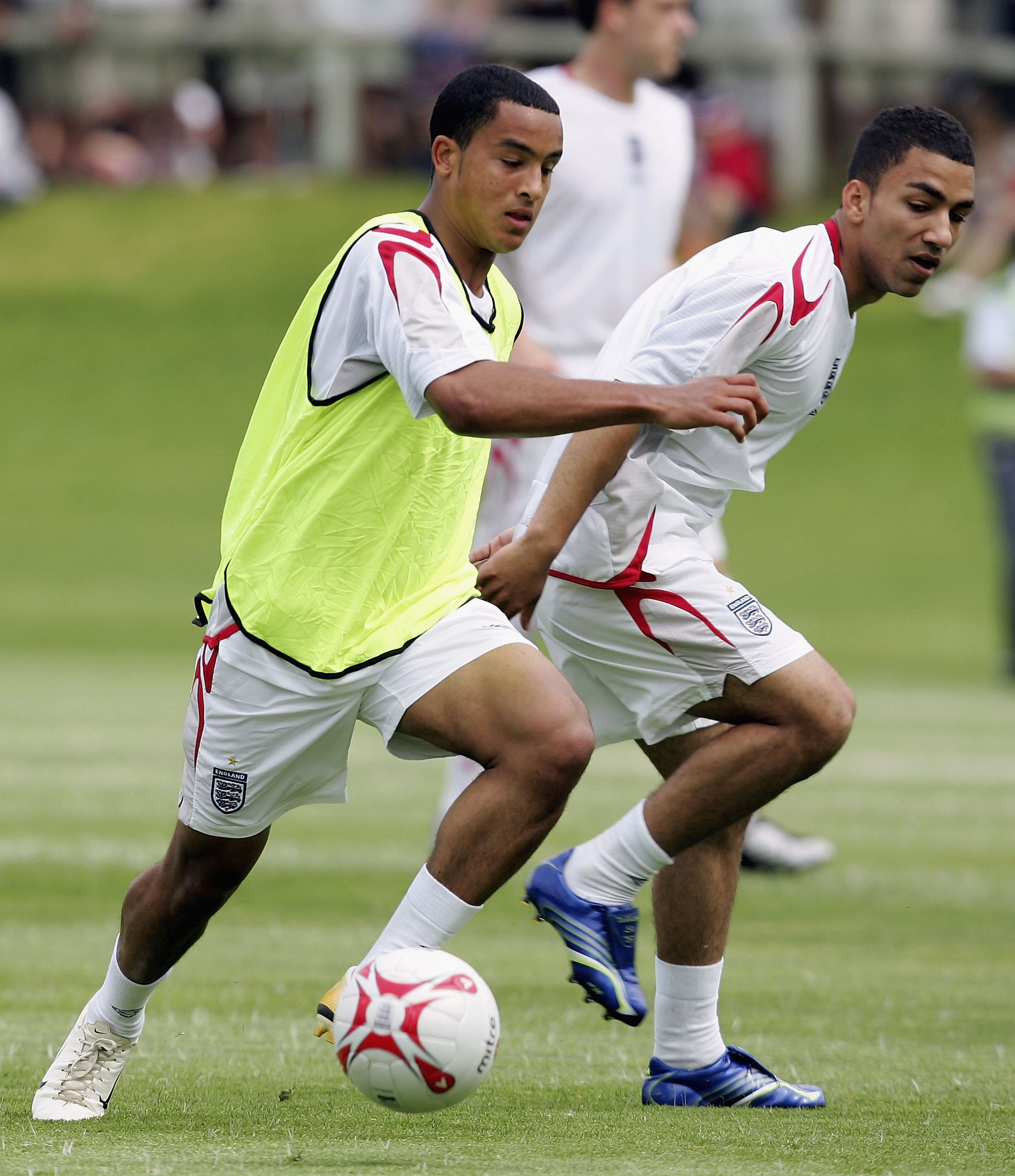 FARO, PORTUGAL - MAY 17:  Theo Walcott and Aaron Lennon of England in action during the squads pre World Cup training camp at Vale do Lobo on May 17, 2006 in Faro, Portugal.  (Photo by Ross Kinnaird/Getty Images)