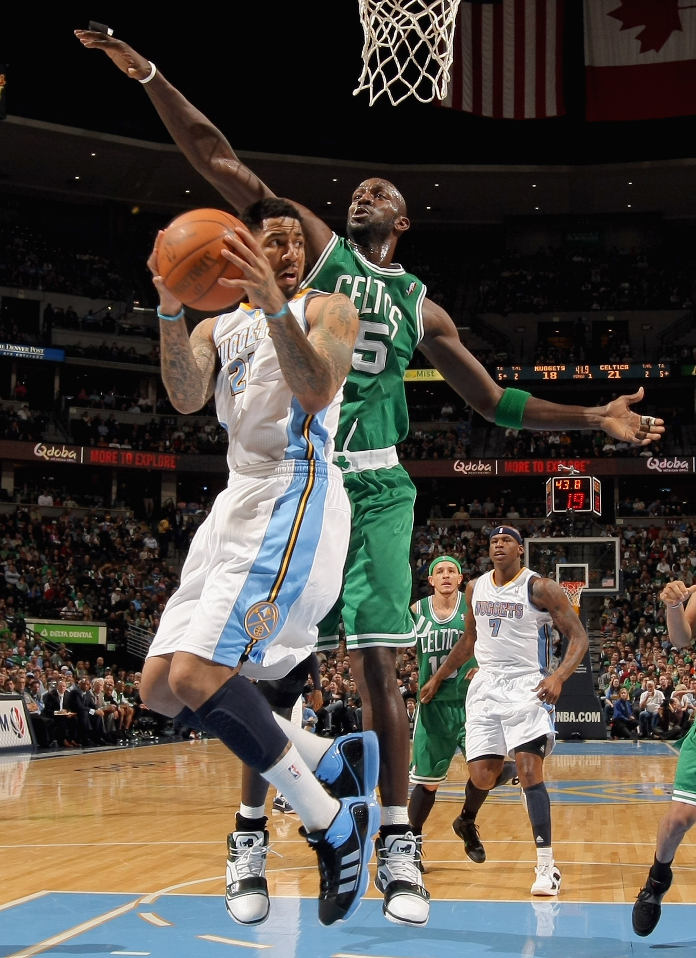 DENVER, CO - FEBRUARY 24:  Wilson Chandler #21 of the Denver Nuggets tries to get off a shot against the defense of  Kevin Garnett #5 of the Boston Celtics during NBA action at the Pepsi Center on February 24, 2011 in Denver, Colorado. NOTE TO USER: User