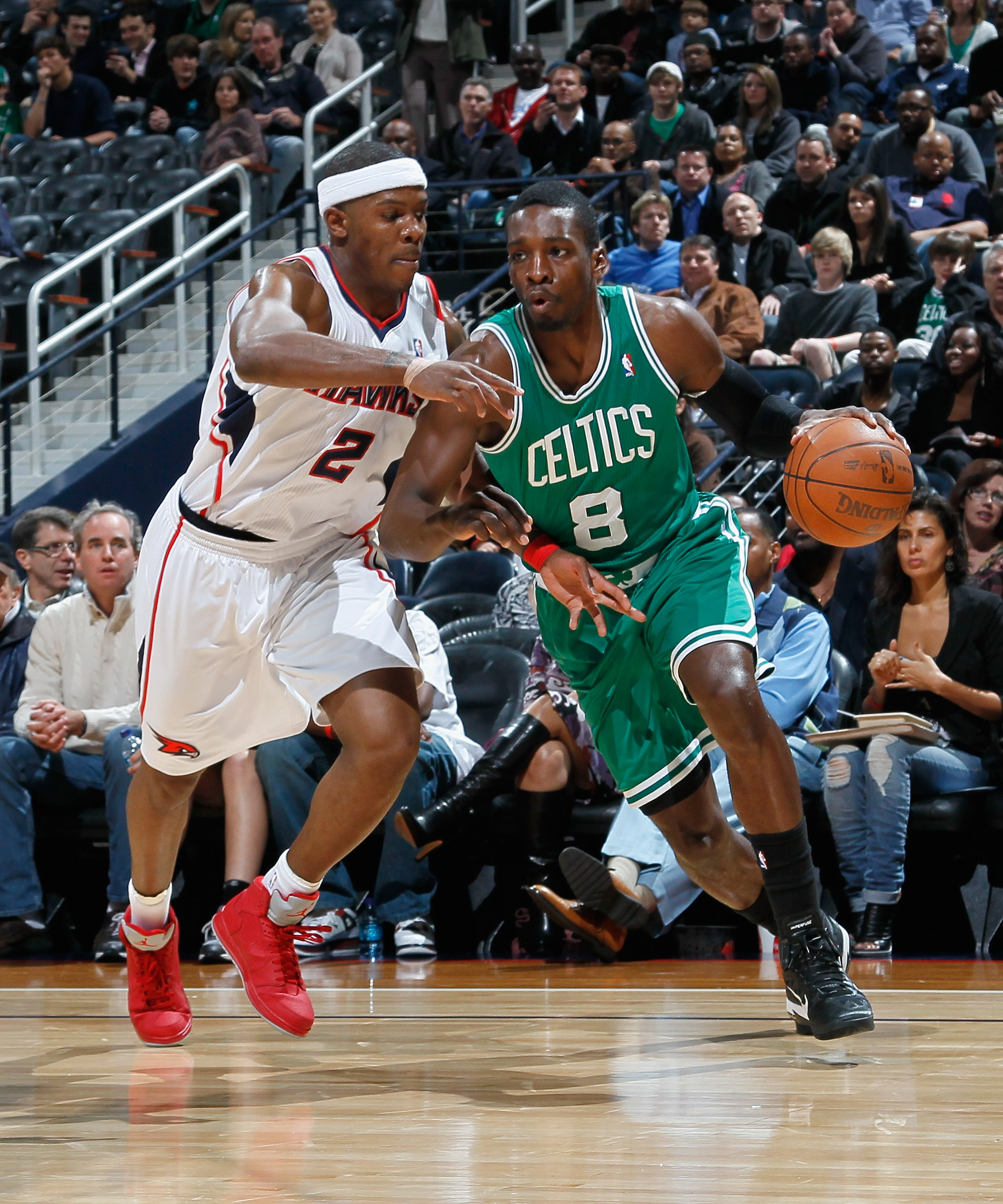 ATLANTA, GA - APRIL 01:  Joe Johnson #2 of the Atlanta Hawks against Jeff Green #8 of the Boston Celtics at Philips Arena on April 1, 2011 in Atlanta, Georgia.  NOTE TO USER: User expressly acknowledges and agrees that, by downloading and/or using this Ph