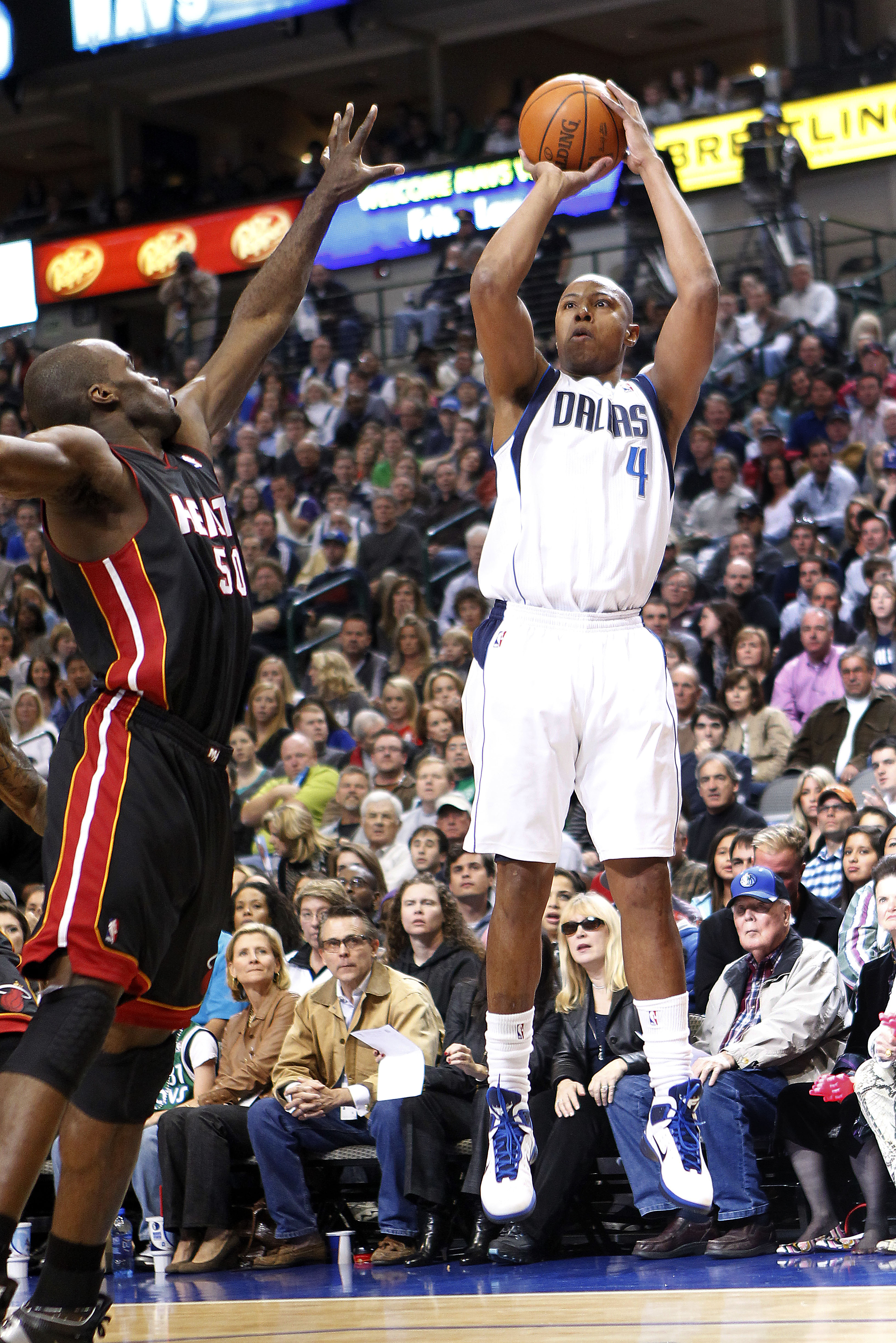 DALLAS - NOVEMBER 27: Caron Butler #4 of the Dallas Mavericks shoots over Joel Anthony #50 of the Miami Heat on November 27, 2010 at the American Airlines Center in Dallas, Texas. NOTE TO USER: User expressly acknowledges and agrees that, by downloading a
