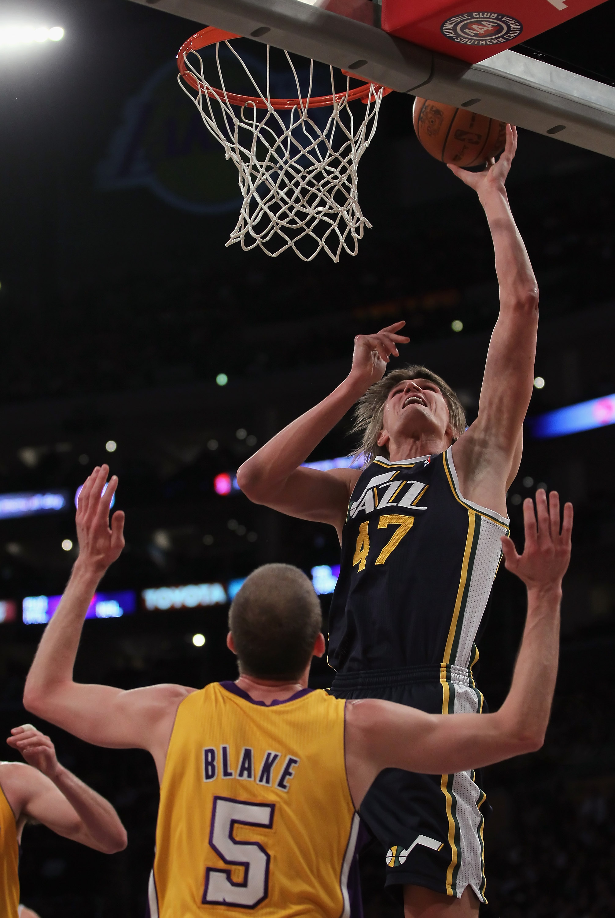 LOS ANGELES, CA - JANUARY 25:  Andrei Kirilenko #47 of the Utah Jazz drives to the basket over Steve Blake #5 of the Los Angeles Lakers in the first half at Staples Center on January 25, 2011 in Los Angeles, California. The Lakers defeated the Jazz 120-91