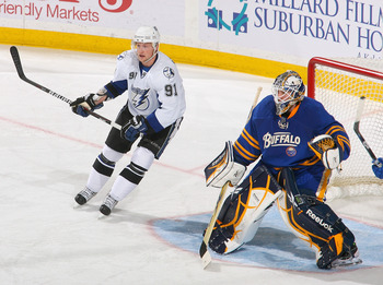BUFFALO, NY - APRIL 05: Steven Stamkos #91 of the Tampa Bay Lightning skates in on Jhonas Enroth #1 of the Buffalo Sabres  at HSBC Arena on April 5, 2011 in Buffalo, New York.  (Photo by Rick Stewart/Getty Images)