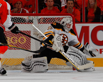 PHILADELPHIA, PA - MAY 02: Goalie Tim Thomas #30 of the Boston Bruins makes a save against the Philadelphia Flyers during the third period of Game Two of the Eastern Conference Semifinals during the 2011 NHL Stanley Cup Playoffs at Wells Fargo Center on M