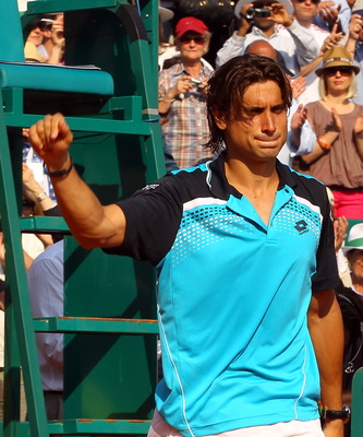MONACO - APRIL 17:  David Ferrer of Spain thanks the support after losing to Rafael Nadal of Spain in the final during Day Eight of the ATP Masters Series Tennis at the Monte Carlo Country Club on April 17, 2011 in Monte Carlo, Monaco.  (Photo by Julian F