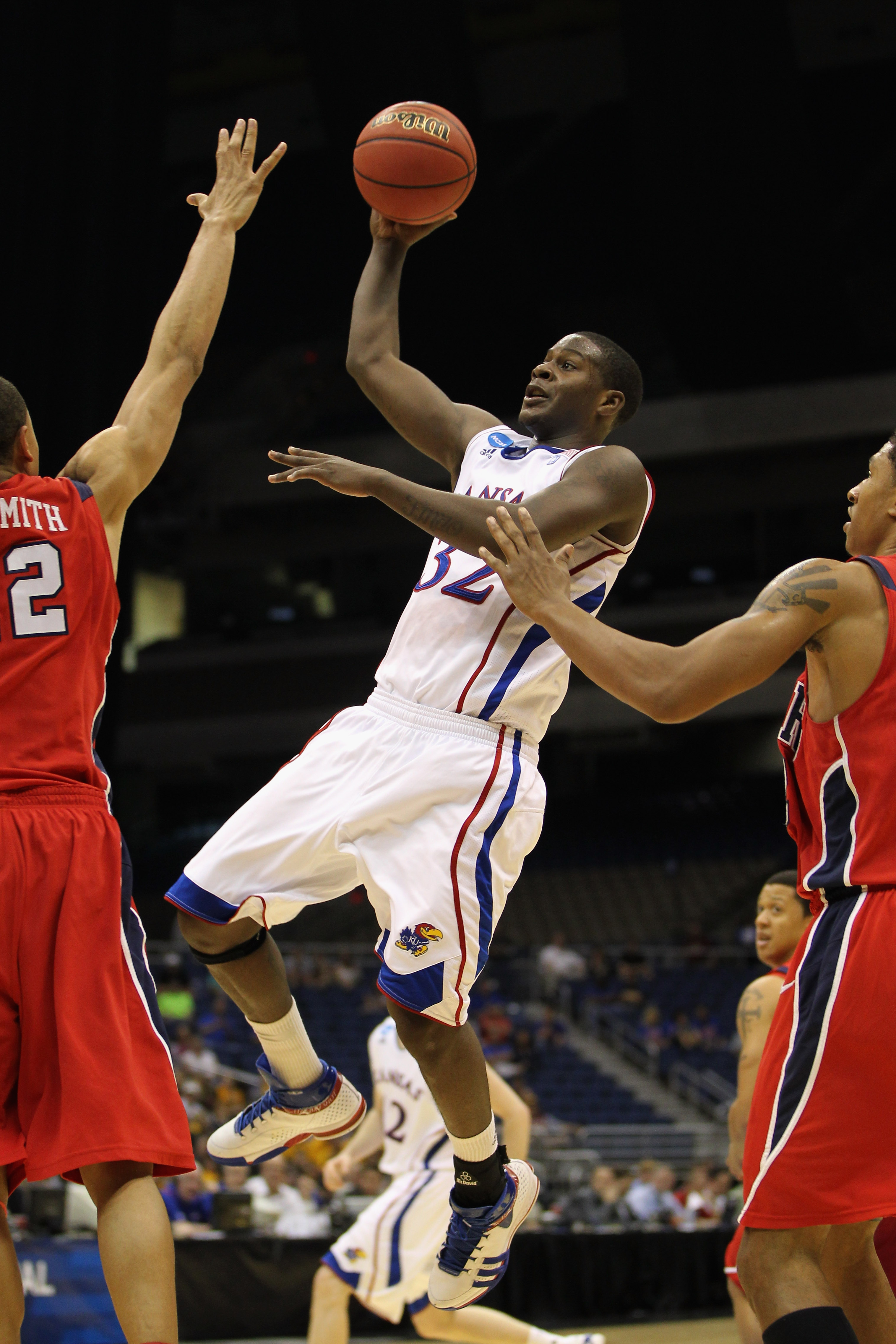 SAN ANTONIO, TX - MARCH 25:  Josh Selby #32 of the Kansas Jayhawks puts up a shot against the Richmond Spiders during the southwest regional of the 2011 NCAA men's basketball tournament at the Alamodome on March 25, 2011 in San Antonio, Texas.  (Photo by