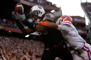 COLUMBIA, SC - NOVEMBER 14:  The Florida Gators try to stop a touchdown catch by Weslye Saunders #88 of the South Carolina Gamecocks during their game at Williams-Brice Stadium on November 14, 2009 in Columbia, South Carolina.  (Photo by Streeter Lecka/Ge