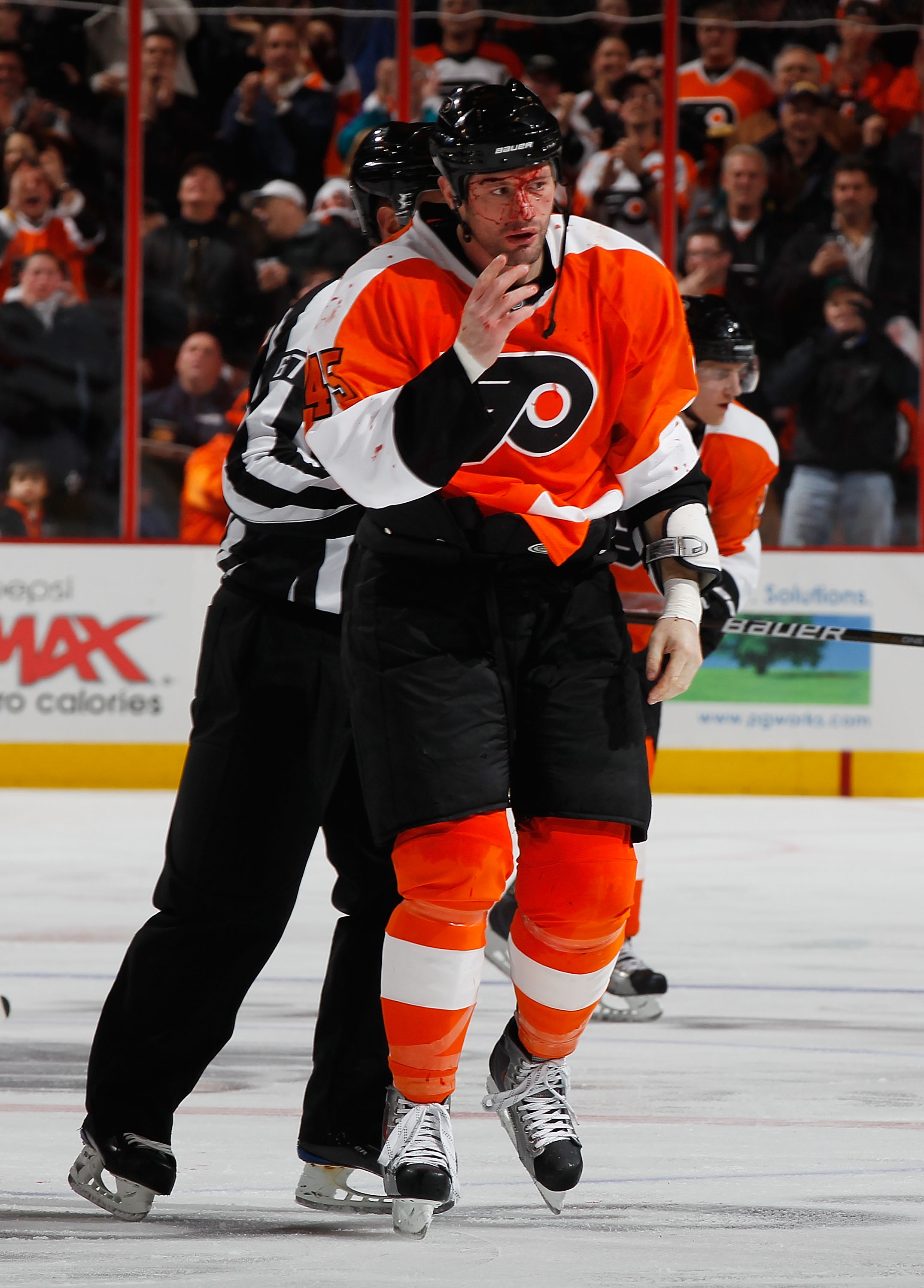 PHILADELPHIA - FEBRUARY 22:  Jody Shelley #45 of the Philadelphia Flyers is escorted off the ice after fighting Nolan Yonkman (not pictured) of the Phoenix Coyotes during the second period on February 22, 2011 at the Wells Fargo Center in Philadelphia, Pe