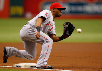 ST. PETERSBURG, FL - MAY 01:  Infielder Alberto Callaspo #6 of the Los Angeles Angels of Anaheim takes the throw at third against the Tampa Bay Rays during the game at Tropicana Field on May 1, 2011 in St. Petersburg, Florida.  (Photo by J. Meric/Getty Im