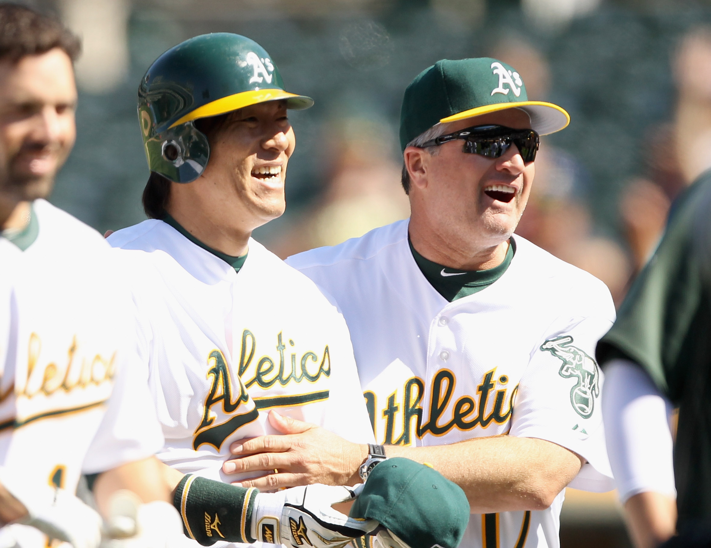 OAKLAND, CA - MAY 02:  Hideki Matsui #55 of the Oakland Athletics is congratulated by manager Bob Geren after he hit a walk off home run to win the game in the tenth inning against the Texas Rangers at Oakland-Alameda County Coliseum on May 2, 2011 in Oak