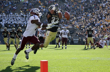 BOULDER, CO - NOVEMBER 07:  Jalil Brown #23 of the Colorado Buffaloes breaks up a third down pass intended for Uzoma Nwachukwu #7 of the Texas A&M Aggies forcing a Texas A&M 47 yard fourth quarter field goal during NCAA college football action at Folsom F
