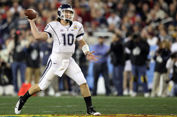 GLENDALE, AZ - JANUARY 01:  Zach Frazer #10 of the Connecticut Huskies  throws the ball against the Oklahoma Sooners during the Tostitos Fiesta Bowl at the Universtity of Phoenix Stadium on January 1, 2011 in Glendale, Arizona.  (Photo by Christian Peters