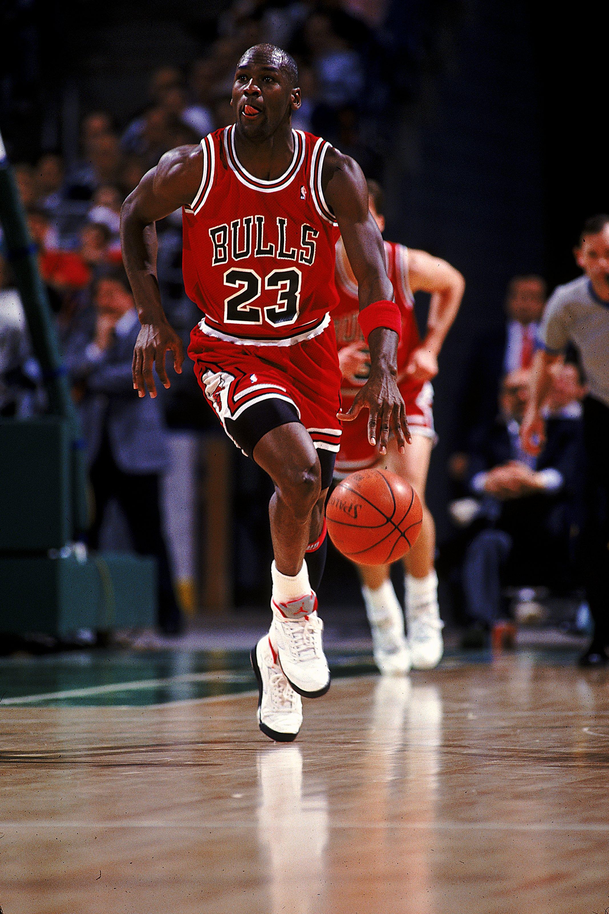 1990:  Michael Jordan #23 of the Chicago Bulls runs with the ball during the game.   Mandatory Credit: Allsport  /Allsport