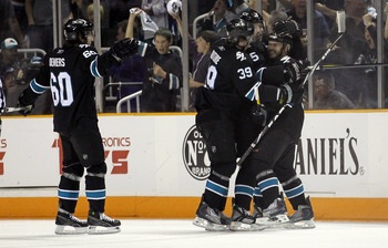 SAN JOSE, CA - MAY 01:  Ian White #9 is congratulated by Dany Heatley #15,Logan Couture #39, and Jason Demers #60 of the San Jose Sharks after he scored a goal in the first period against the Detroit Red Wings in Game Two of the Western Conference Semifin