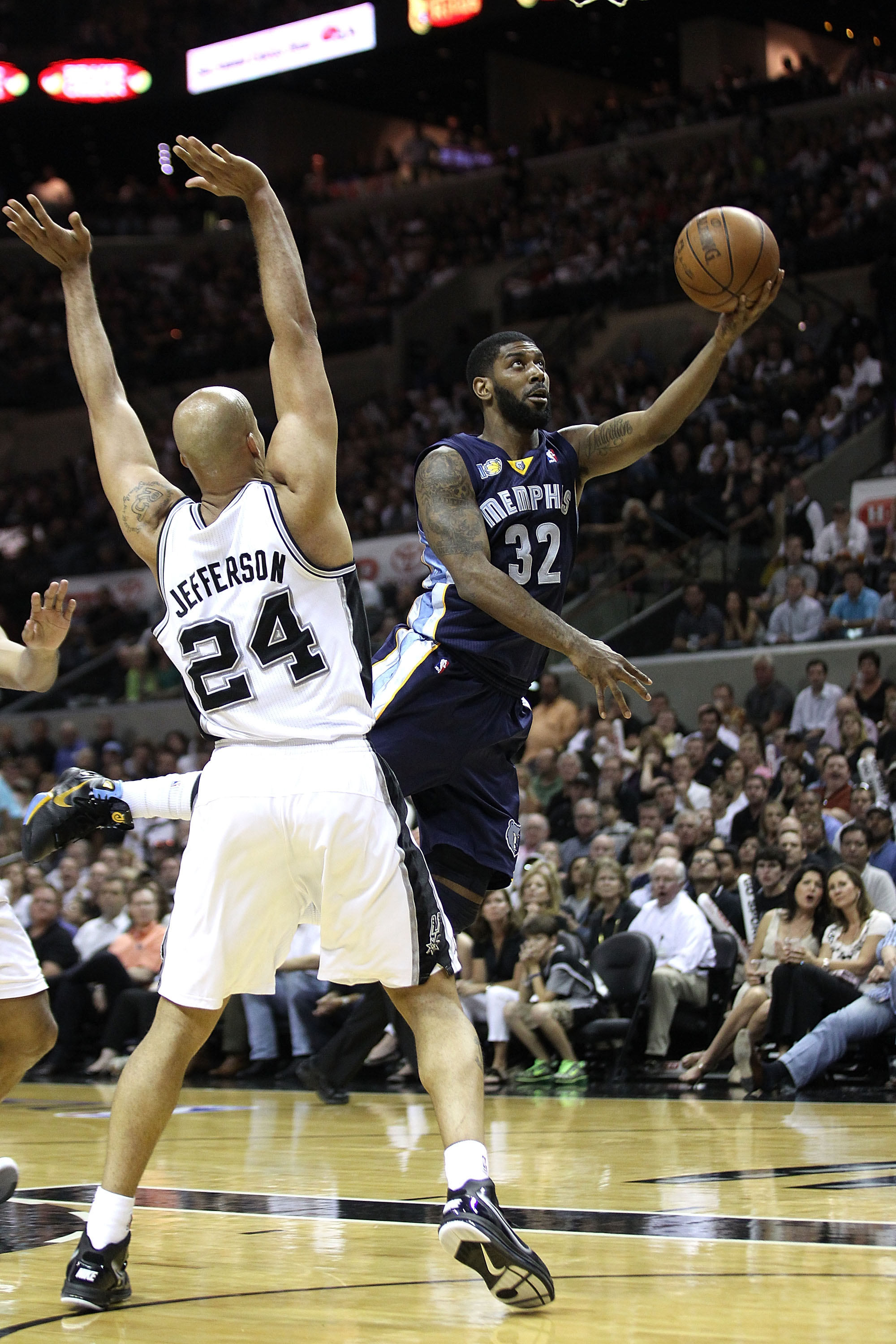 SAN ANTONIO, TX - APRIL 27:  O.J. Mayo #32 of the Memphis Grizzlies shoots against Richard Jefferson #24 of the San Antionio Spurs in Game Five of the Western Conference Quarterfinals in the 2011 NBA Playoffs on April 27, 2011 at AT&T Center in San Antoni