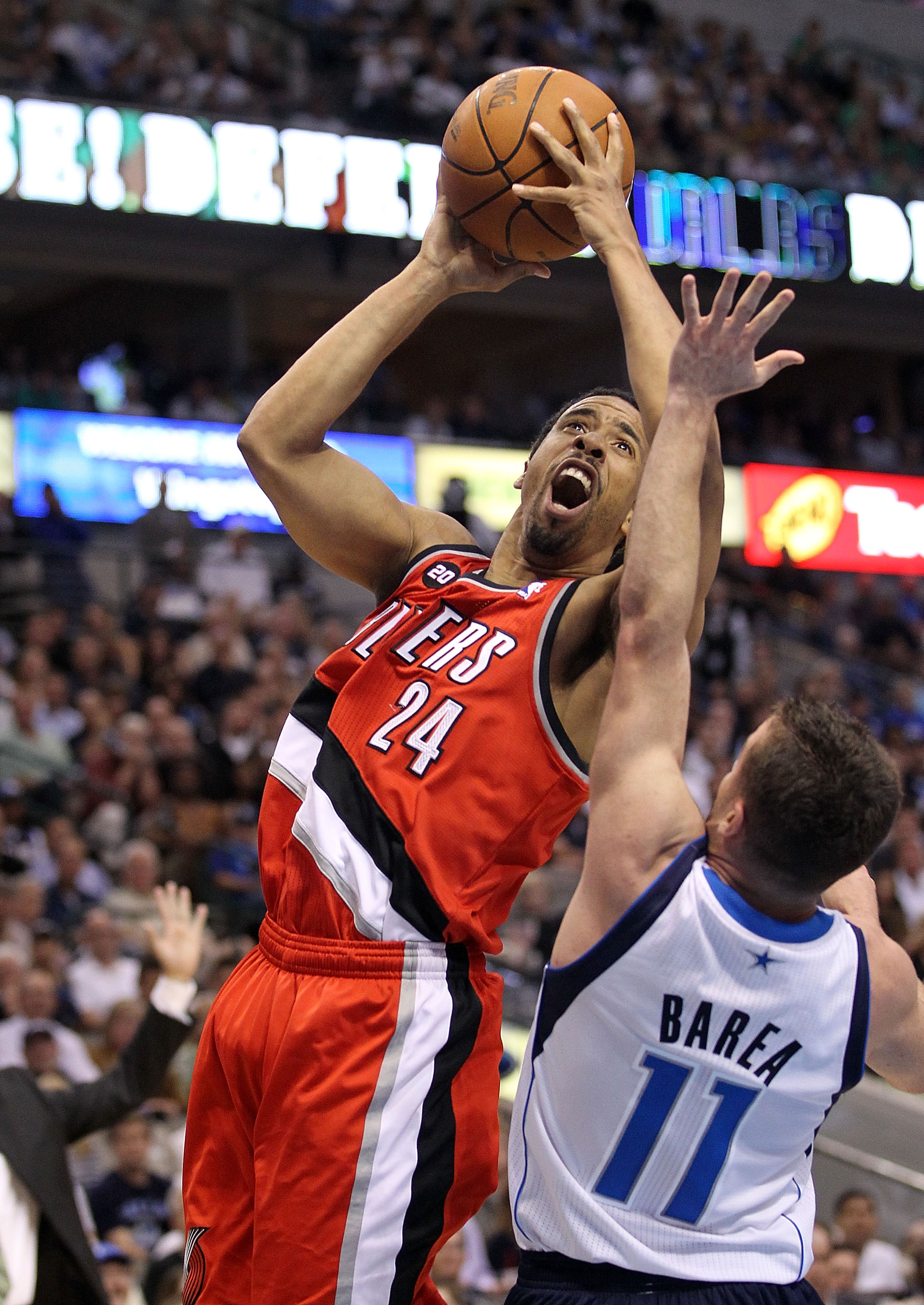 DALLAS, TX - APRIL 19:  Guard Andre Miller #24 of the Portland Trail Blazers takes a shot against Jose Juan Barea #11 of the Dallas Mavericks in Game Two of the Western Conference Quarterfinals during the 2011 NBA Playoffs on April 19, 2011 at American Ai