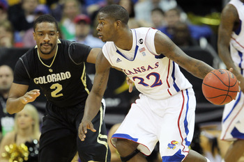 KANSAS CITY, MO - MARCH 11:  Josh Selby #32 of the Kansas Jayhawks drives with the ball against Shannon Sharpe #2 of the Colorado Buffaloes during their semifinal game in the 2011 Phillips 66 Big 12 Men's Basketball Tournament at Sprint Center on March 11