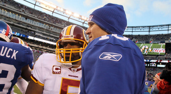 EAST RUTHERFORD, NJ - DECEMBER 05: Donovan McNabb #5 of the Washington Redskins meets with Eli Manning #10 of the New York Giants after their game on December 5, 2010 at the New Meadowlands Stadium in East Rutherford, New Jersey. The Giants defeated the R