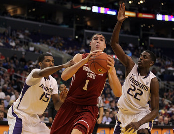 LOS ANGELES, CA - MARCH 10:  Klay Thompson #1 of the Washington State Cougars drives between Scott Suggs #15 and Justin Holiday #22 of the Washington Huskies in the first half in the quarterfinals of the 2011 Pacific Life Pac-10 Men's Basketball Tournamen