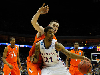 TULSA, OK - MARCH 20:  Markieff Morris #21 of the Kansas Jayhawks drives with the ball against Mike Tisdale #54 of the Illinois Fighting Illini during the third round of the 2011 NCAA men's basketball tournament at BOK Center on March 20, 2011 in Tulsa, O