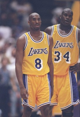10 May 1997:  Guard Kobe Bryant (left) and center Shaquille O''Neal of the Los Angeles Lakers walks down the field during a playoff game against the Utah Jazz at the Great Western Forum in Inglewood, California.  The Jazz won the game 110-95. Mandatory Cr