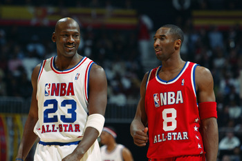 ATLANTA - FEBRUARY 9:  Michael Jordan (Washington Wizards) #23 of the Eastern Conference All-Stars talks with Kobe Bryant (Los Angeles Lakers) #8 of the Western Conference All-Stars at the 2003 NBA All-Star Game on February 9, 2003 at Philips Arena in Atl