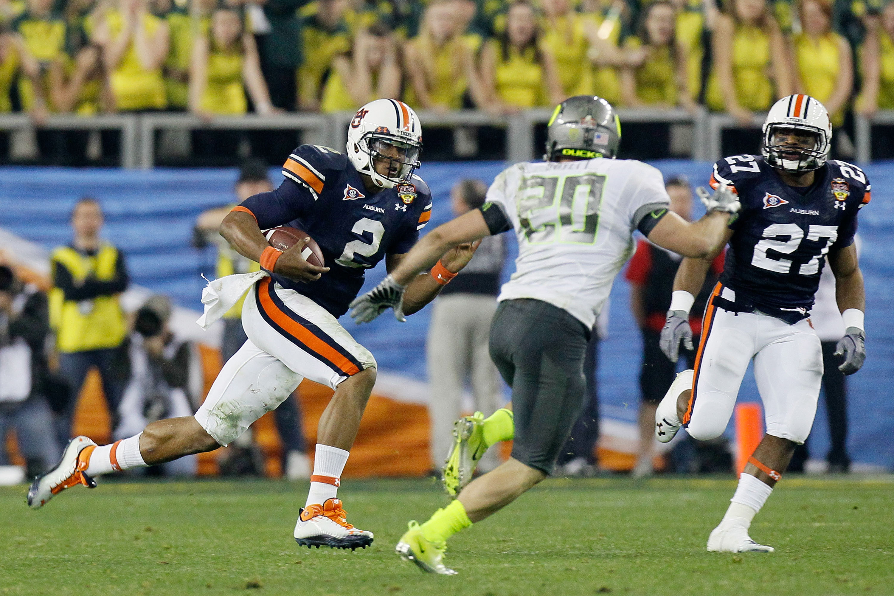 GLENDALE, AZ - JANUARY 10:  Cameron Newton #2 of the Auburn Tigers runs down field against John Boyett #20 of the Oregon Ducks during the Tostitos BCS National Championship Game at University of Phoenix Stadium on January 10, 2011 in Glendale, Arizona.  (