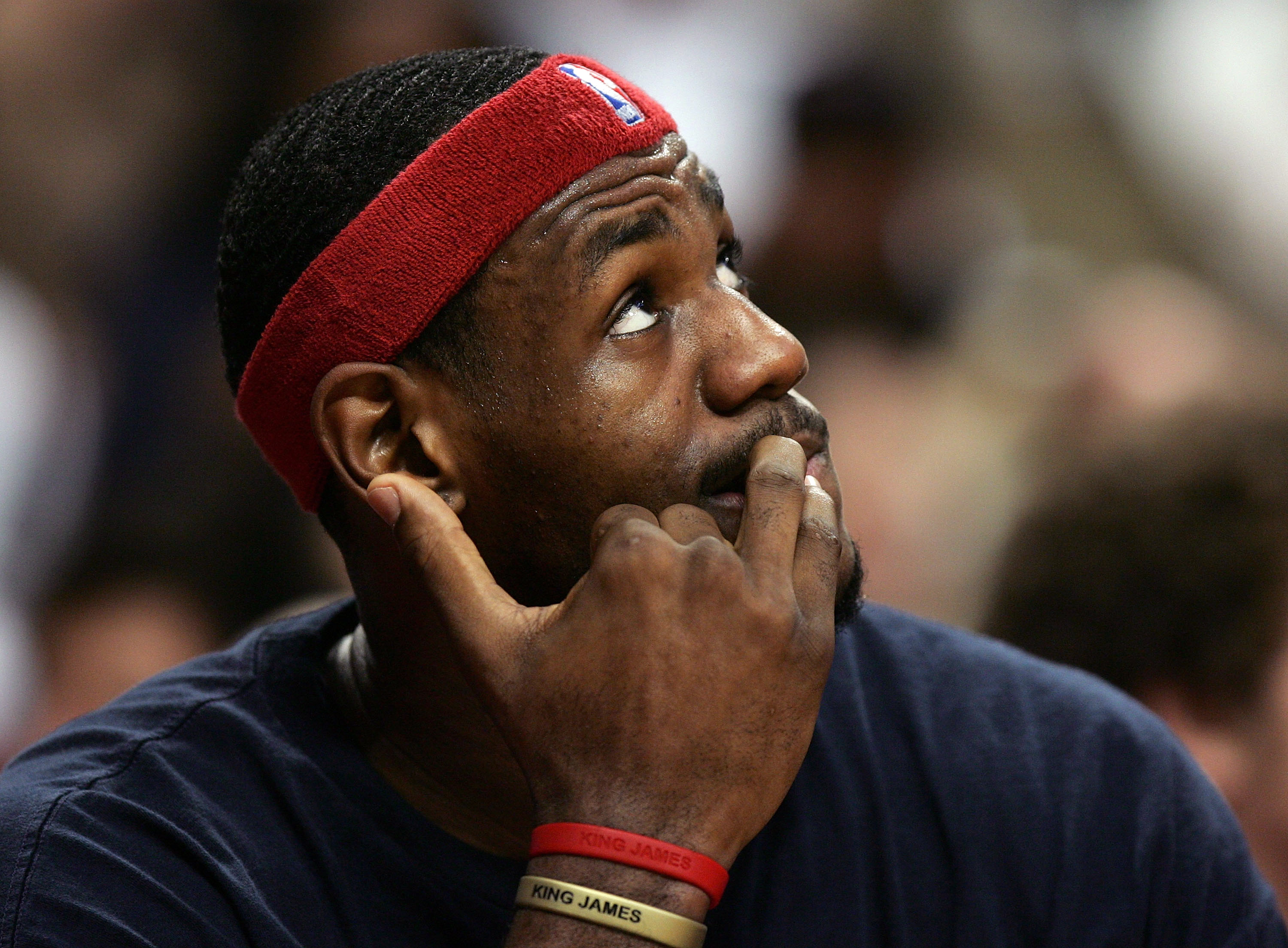CHICAGO - DECEMBER 22:  LeBron James #23 of the Cleveland Cavaliers watches the replay board and bites his nails while sitting on the bench during a game against the Chicago Bulls on December 22, 2005 at the United Center in Chicago, Illinois.  NOTE TO US