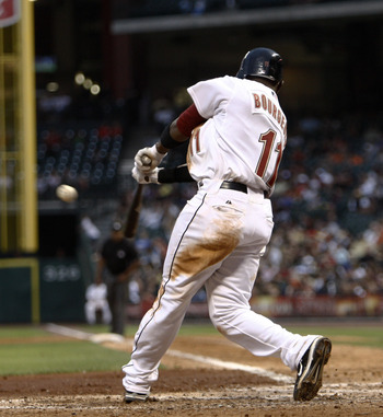 HOUSTON - APRIL 30:  Jason Bourgeois #11 of the Houston Astros doubles on a line drive to left field in the fifth inning against the Milwaukee Brewers at Minute Maid Park on April 30, 2011 in Houston, Texas.  (Photo by Bob Levey/Getty Images)