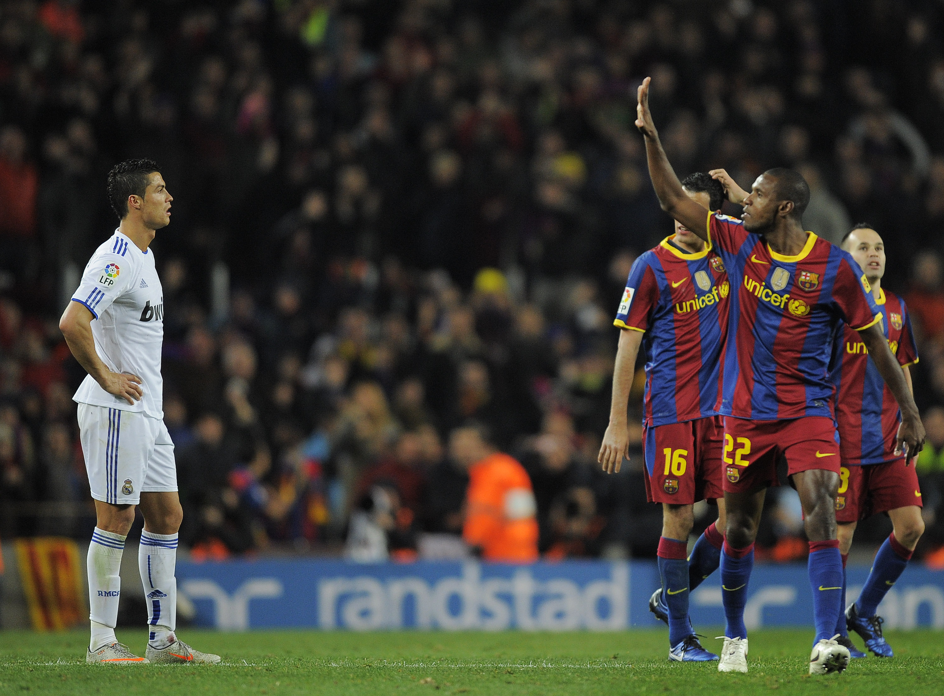 BARCELONA, SPAIN - NOVEMBER 29:  Cristiano Ronaldo of Real Madrid (L) looks on as Eric Abidal (2ndR) of Barcelona gestures after Barcelona  scored five goals againts Real Madrid, during the La Liga match between Barcelona and Real Madrid at the Camp Nou S