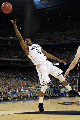 HOUSTON, TX - APRIL 04:  Kemba Walker #15 of the Connecticut Huskies goes to the basket against of the Butler Bulldogs during the National Championship Game of the 2011 NCAA Division I Men's Basketball Tournament at Reliant Stadium on April 4, 2011 in Hou